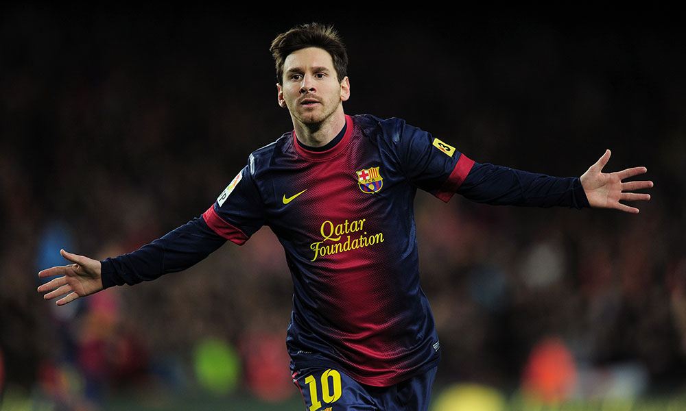 (FILES) A picture taken on December 16, 2012 shows Barcelona's Argentinian forward Lionel Messi celebrating after scoring a goal during the Spanish league football match FC Barcelona vs Atletico de Madrid at the Camp Nou stadium in Barcelona. Messi has agreed on December 18, 2012 to renew his contract with FC Barcelona until June 2018.AFP PHOTO / LLUIS GENE        (Photo credit should read LLUIS GENE/AFP/Getty Images)